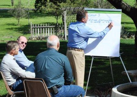 Armstrong participates in a group meeting on the county's future