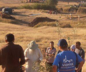Isha guru and volunteers and temporary tent.
