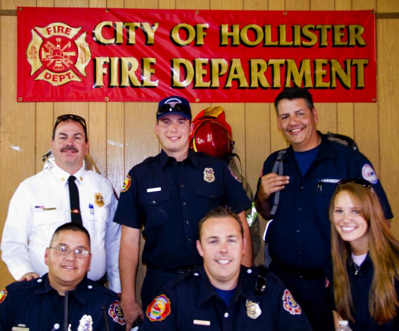 HFD Chief O'Connor with figherfighters and a couple AMR medics