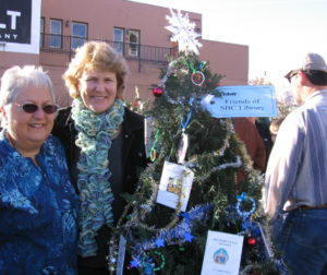 Rebecca Salinas & Susan Logue, Friends of the Library Board members with tree