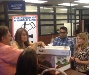 Mary and Andy Hsia-Coron turn in more than 4,000 signatures to election officials.