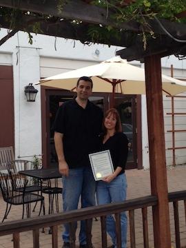 Dmitri and Kitty Fridman outside Vertigo Coffee.