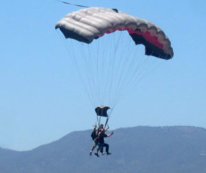 Hollister City Manager Bill Avera participated in the opening ceremony as part of a tandem skydive.