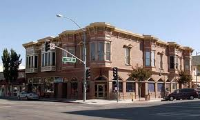 The building on the corner of Fifth and San Benito was damaged in the quake, but was saved from demolition. Photo courtesy of farmersagent.com.