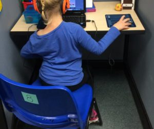 Student Utilizing New Technology In The Classroom