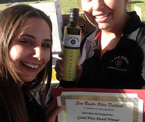 Nicole and Laura of Lucero Olive Oil proudly display a bottle of Ascolano, the grand prize winner in the extra-virgin olive oil category.