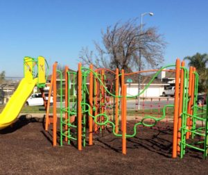 Park includes new swings on bright blue poles.
