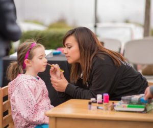 Kai 4 and a half gets her face painted at the Go Kids inc booth.jpg
