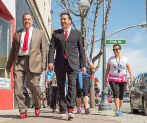 Mayor Ignacio Velazquez and County Supervisor Jaime De la Cruz strut down San Benito street..jpg