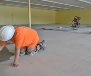Putting finishing touches on floor for new Dollar Store.