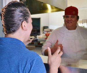 Naomi Ruiz, the new owner of FlapJacks Breakfast & Grill, talks with Reyes Lobato, Chef and Kitchen Manager.