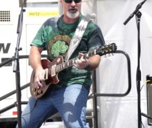 Michael Osborn plays guitar solo during the Michael Osborn Band performance on Friday afternoon.