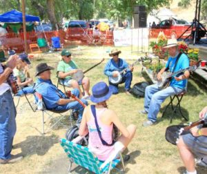 BanjerDan, right, leads a Bluegrass Banjo Techniques workshop.