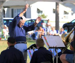 Joe Ostenson conducts during the performance of Mr. O's Jazz Band as the second act in Music in the Park.