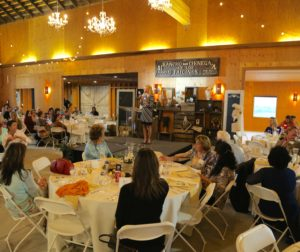 Stephanie Hicks with the Community Foundation for San Benito County Women's Fund speaks to a packed house.