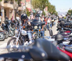A line of bikers wait to drive past a crosswalk.jpg