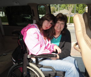 Amy Miller and her mother, Karen, try out the new van.