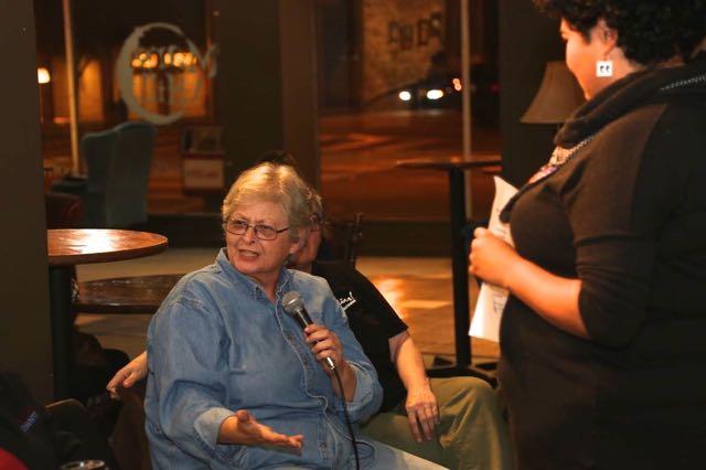 Moderator Rachelle Escamilla listens to resident Debbie Cusic's opinion.