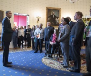 obama talks to those affected by gun violence.jpg