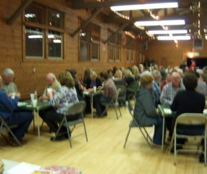 Annual Pedro Party Participants Playing Cards at Tres Pinos Hall