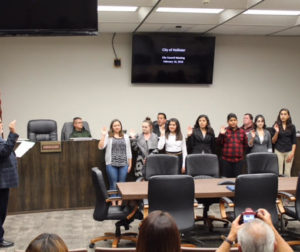 The first youth committee is sworn in during city council meeting.