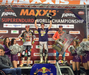 Colton Haaker (center) celebrates his win in Madrid. Cody Webb on right and Jonny Walker (GB) on left.