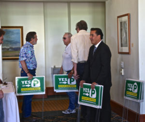 """Hollister Mayor Ignacio Velasquez  hands out """"Yes on P"""" signs."""