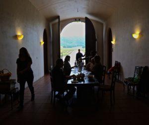 Great wooden doors open to Pietra Santa's serene view.