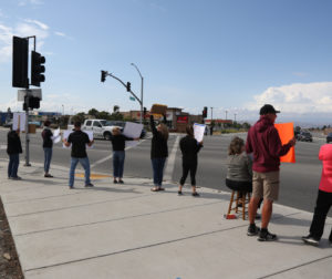 Protesters lined up along Tres Pinos Road and Highway 25