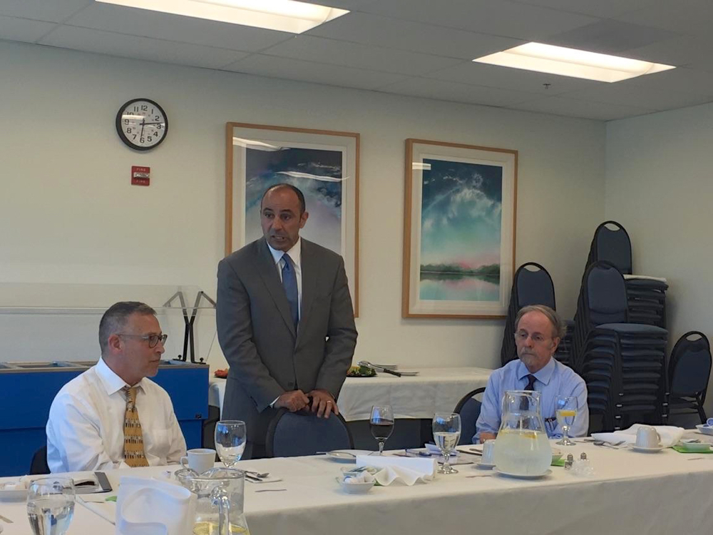 Jimmy Panetta (center) speaks to San Benito Medical Associates members.
