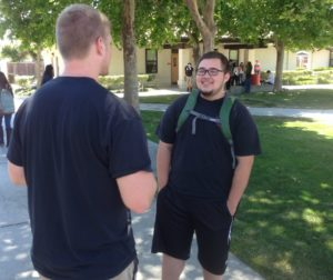 Alyx Beltran (pictured right) speaks to his friend, Zack. Photo by Frank Perez.