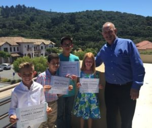 Four art contest winners with Supervisor Muenzer at Monterey Bay Air Resources District