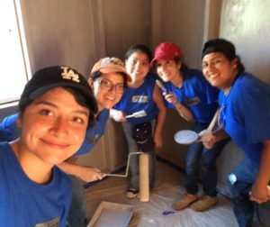 Mirian Martinez and co-volunteers help build a home in Tecate, Mexico.