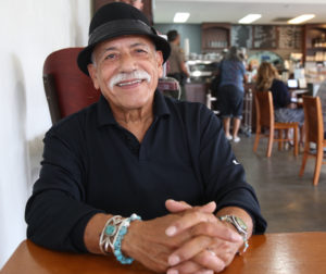 Cesar Flores takes a break with reporter Leslie David at Vertigo in San Juan Bautista.  Leslie David photo