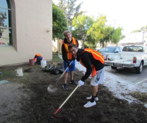 Jake Jenfen and Ethan Gonzalez work on the Library grounds
