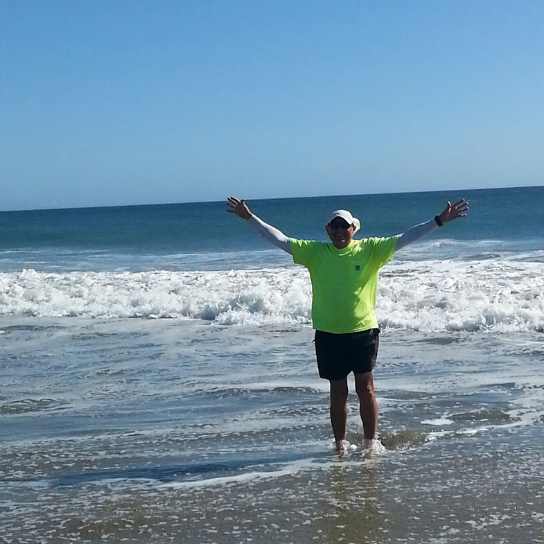 Jim Ostdick stands in the Pacific Ocean.