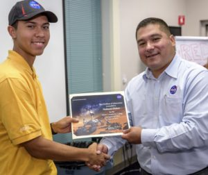 Gavilan College Sophomore, Nathan Herbert (left), receives his NCAS certificate of completion from NCAS workshop educational coordinator, Gabriel Dueñas. Photo courtesy of NASA Ames / Don Richey.