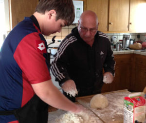 Nonno (grandpa) Stelvio Locci with grandson Christopher Chambless at 15 starting to build the volcano of flour and eggs.