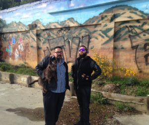 Rolan Resendiz and Joel Esqueda, local artists in front of vandalized mural.