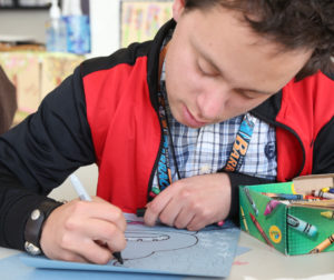 Life Skills Arts Program participant Adam Bell works on another art piece. Photos courtesy of Leslie David Photos.