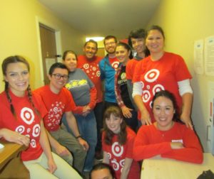 Target employees volunteer to paint the interior of the Emmaus House in Hollister