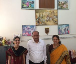 (left to right) Devii Rao, Dr. K. Satyanarayan and Dr. Jagadeeswary at the Veterinary University in Bengaluru with beautiful scenes of agricultural life depicted above us on the wall. Photo credit: Daniel George.