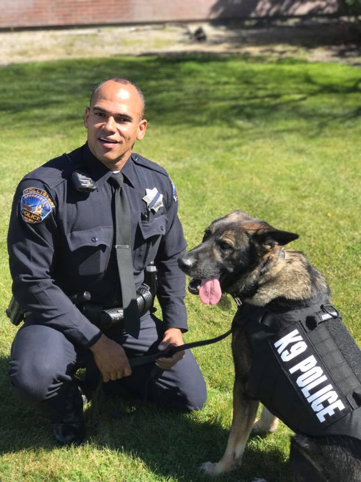 Officers Miguel Masso and Dallas in 2017. File photo.