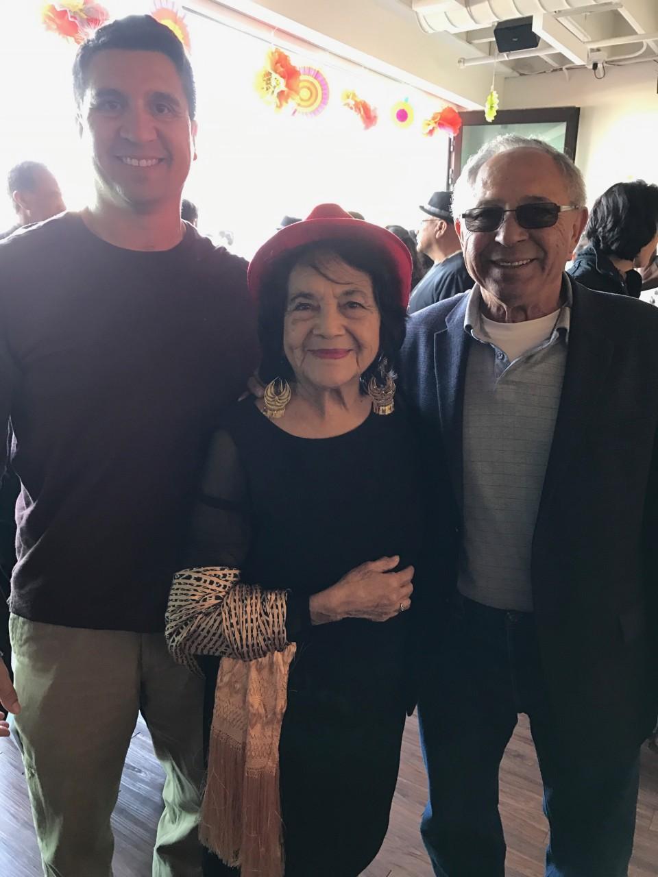 L-R: BenitoLink reporter, Frank Perez, Dolores Huerta, and the reporter's father, Frank Perez. Photo courtesy of Rick Rivas.