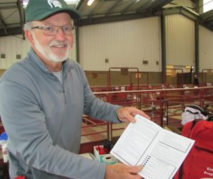 John Crepeau, volunteer of Red Cross hands out material about disaster readiness