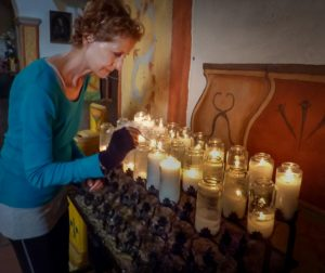 Edie Littlefield Sundby lighting candles at Mission San Juan Bautista on Day 45 of her mission walk. Photos courtesy of Edie Littlefield Sundby.