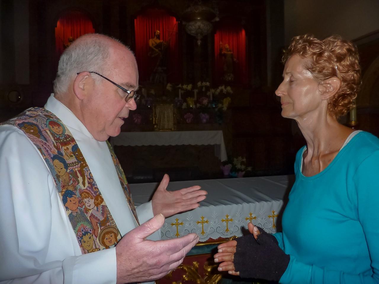 Edie receiving blessing from SJB priest Fr. James Henry.jpeg