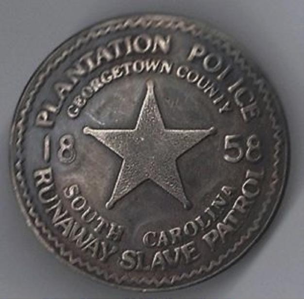 Slave Police Badge.png