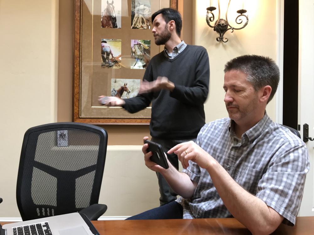 CMAP TV's Ian Slattery runs Adam Breen and the BenitoLink staff through the news capabilities of the iphone.  L.David photo