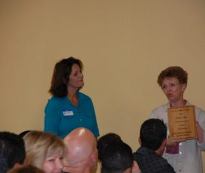 Trustee Lois Locci presents the award to San Benito County Cattlewomen in 2015.